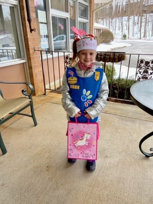 Avery Fisher delivers 20 valentines made by members of Penfield's Millwheel SU, Daisy Troop 60824 to residents of Penfield Place.