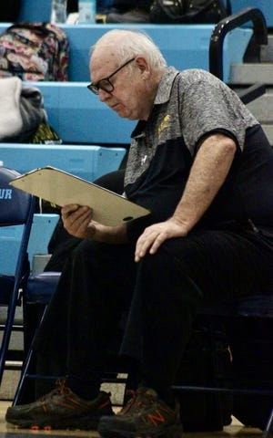 Bob Shook is pictured sitting on the bench at a Keyser girls' basketball game.Shook has spent many years helping coach and keep stats for the team and has catalogued over a century's worth of research on girls' basketball in West Virginia and at Keyser High School.
