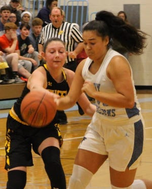 Frankfort's Marie Perdew and Keyser's Kaili Crowl do battle in basketball action last season.  The beginning of winter sports' practices in Mineral County, originally slated for Monday, was delayed due to weather.
