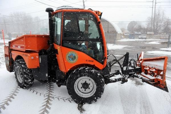 A Milford DPW worker clears a path during a January 2018 storm.