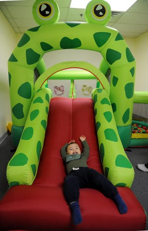 Liam Dias, 19 months old, enjoys himself at Let's Bee Kids Play Center in Hudson, Feb. 15, 2021.