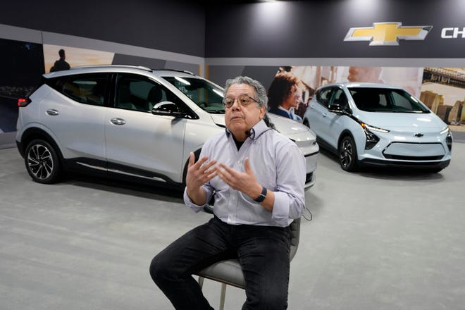 Jesse Ortega, Chevrolet Bolt EUV executive chief engineer, is interviewed beside a 2022 Bolt EUV, left, in Milford, Mich., Feb. 11, 2021.