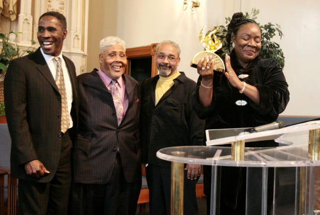 In this 2008 photo, Cecilia Wallace (right) presents the Stella Gospel Music Award for Quartet of the Year to (from left) Steve Allen, Rance Allen, and Thomas Allen during a ceremony at New Bethel Church of God in Christ in Toledo.