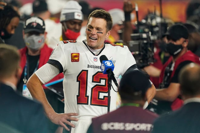 Tampa Bay Buccaneers quarterback Tom Brady is interviewed on the field after the NFL Super Bowl 55 football game against the Kansas City Chiefs on Feb. 7 in Tampa.