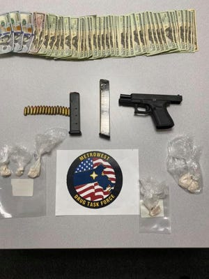The MetroWest Drug Task force seized fentanyl, a gun and cash as part of an investigation, Feb. 12, 2021. Two people were arrested.