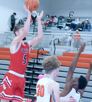 Ottawa High School sophomore rises above the Bonner Springs defense to score a jumper in the lane.