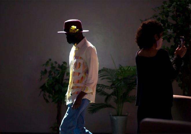 Palm Beach Habilitation Center client Terrence Watkins walks during the fashion show.