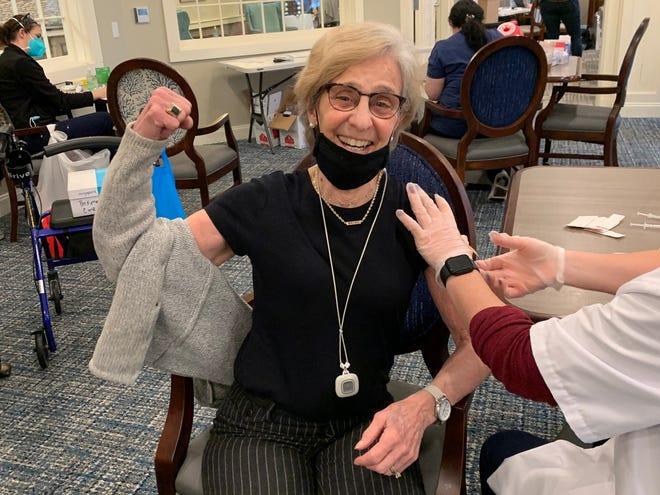 Cornerstone at Hampton resident Cheryl Ryan receives her first dose of the Pfizer vaccine.