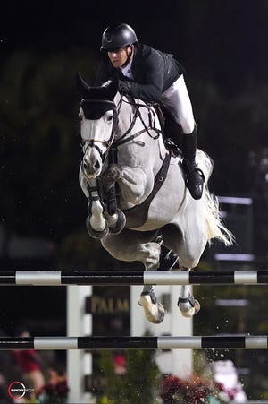 Shane Sweetnam and Alejandro won Saturday night's grand prix with a time of 37.03 seconds in the nine-rider jumpoff.