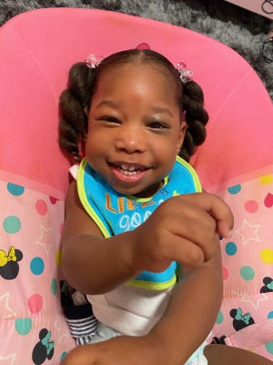 Zoe Jones, 2, is not bothered by the obstacles she faces as a child with a severe form of cerebral palsy.