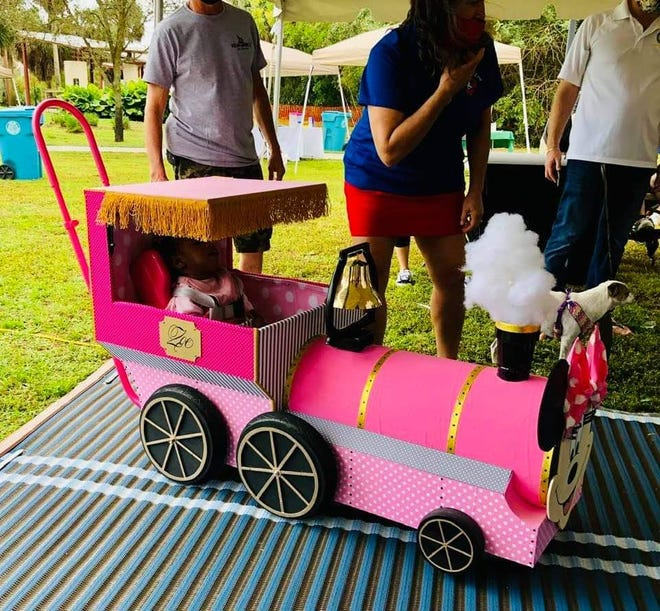 The Minnie Mouse-themed wheeled chair was presented to Zoe Jones in a special ceremony on Feb. 13.