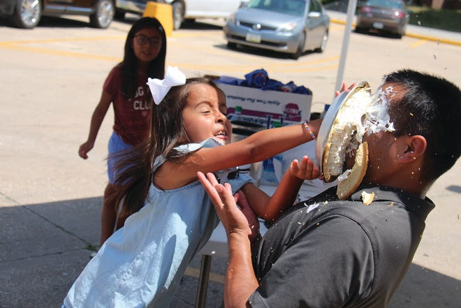 Sofia Diaz-Cardenas throws a pie in the face of Eddie Diaz during the Big Boom Bracket Battle Final Showdown on Friday, July 3 at Fareway. The photo took first place in the annual Iowa Newspaper Association contest in the best news feature photo category.