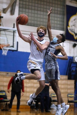 Brigham Dunphy (shown in action earlier this week) and the Barrington boys basketball team found themselves in a tight game, then turned it around with a dominant performance in the fourth quarter to take down Smithfield Friday night.