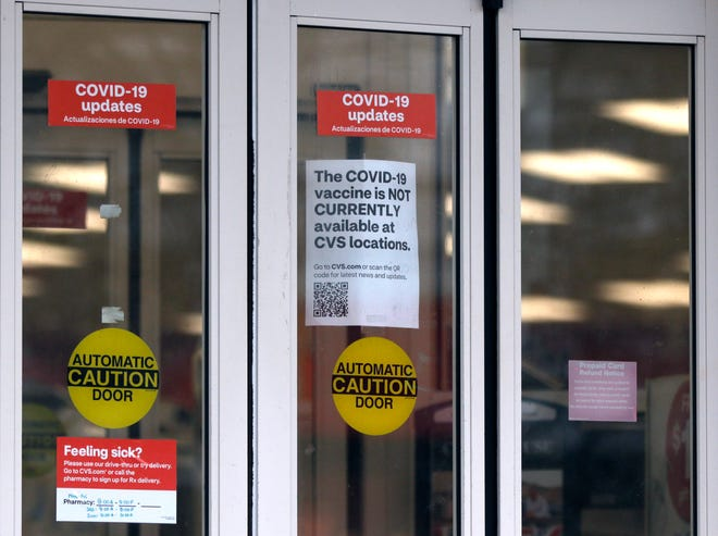 The sign at a CVS in Barrington tells customers that no COVID-19 vaccine was available Monday. The state has received 228,650 doses of vaccine, according to the CDC, and had administered 148,335 doses, according to the state Department of  Health.
