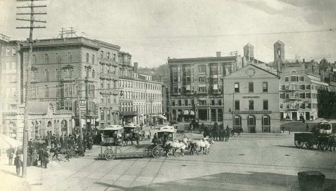 Trolleys and horse-drawn carriages in Providence's Market Square in 1890.
