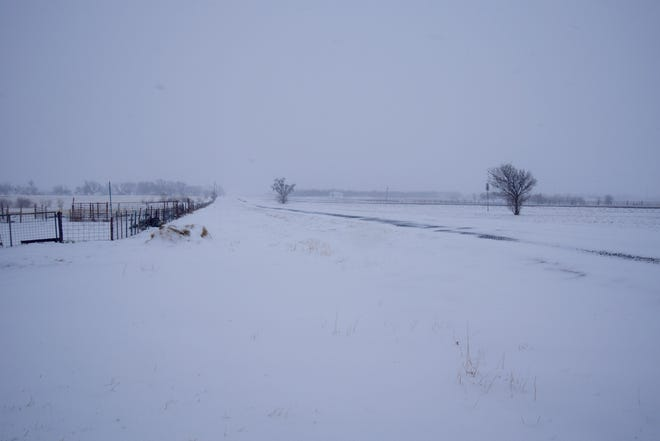 A historic cold front that brought a blizzard and whiteout conditions struck Runnels County between Thursday and Tuesday. This photo is of Highway 67 and the frontage road  south of Ballinger.