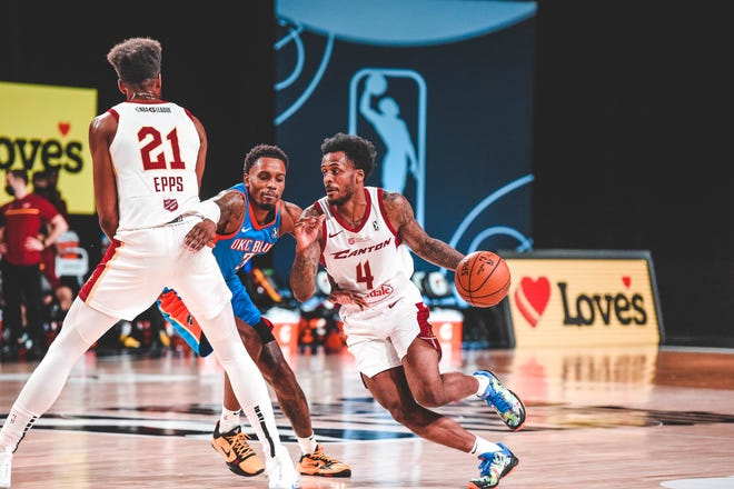The Charge's Antonio Blakeney (4) works off an Aaron Epps screen against the Oklahoma City Blue during an NBA G League game earlier this month at AdventHealth Arena in Orlando, Florida.