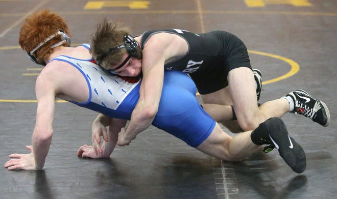 Cameron Zollars (right) of Perry defeated Thomas Cassetty of Lake in a 120 pound bout at Perry on Monday, Feb. 15, 2021.