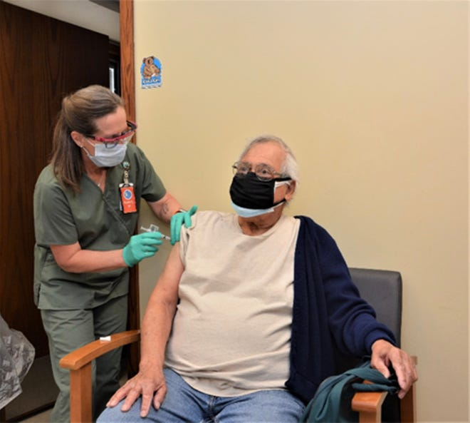 Veteran Raymond Hernandez, who served in the South Pacific with the Coast Guard during the Korean War, gets his first dose of the COVID-19 vaccine from registered nurse Beverly Novak in Salina.