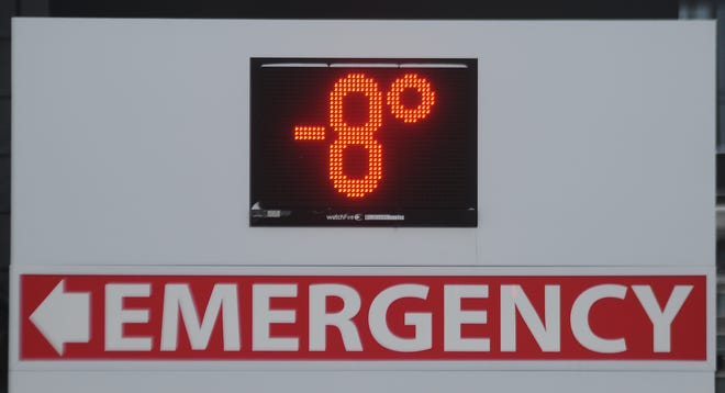 """The Salina Regional Health Center sign shows the temperature at minus 8 degrees at 8 a.m. Monday. The low temperature record for Salina of minus 7 set in 1905 was beat on Monday with a low of minus 10 degrees. """"The temperature could drop even more tonight,"""" said Chris Jakub, meteorologist with the National Weather Service in Wichita."""