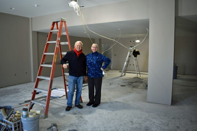 Longtime ACTORS members Stan Rabe and Lynn Lloyd pose in the expanded main space in the theater, which now has a higher ceiling and twice as much square footage. It will be used for gathering before and after productions and will double as a second rehearsal space.