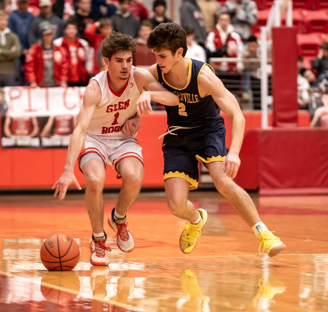 Stephenville's Kyle Styron (2) defends Glen Rose's Kolton Mooney on Friday night at Tiger Arena.