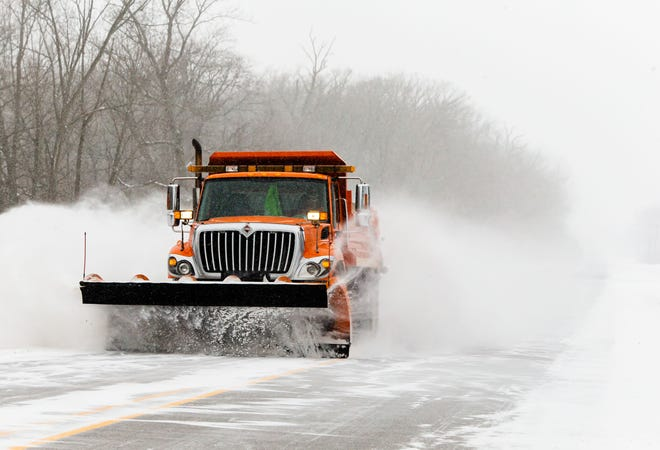 A snow plow heads east along along Spaulding Orchard Road with temperatures hovering around 2 degrees in Springfield, Ill., Monday, February 15, 2021. The City of Springfield's Office of Public Works announced a Snow Emergency will be in effect on designated snow routes starting at 12:00 p.m. Monday, February 15th and ending at 7:00 a.m. Friday, February 19th. [Justin L. Fowler/The State Journal-Register]
