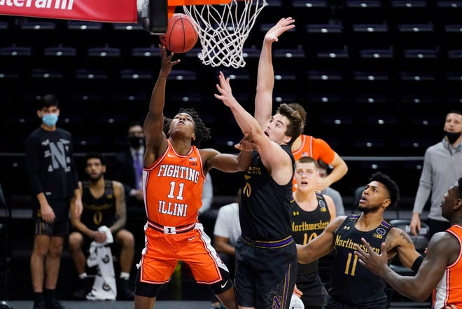Illinois guard Ayo Dosunmu, left, shoots during the first half against Northwestern in Evanston, Thursday, Jan. 7. (AP Photo/Nam Y. Huh)