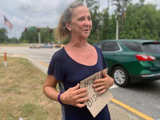 Judy Smith panhandles at the intersection of Truman Parkway and Abercorn Street.