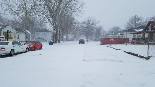 Residential streets were quiet Sunday afternoon, with many staying off the roads due to the winter storm passing through the area.