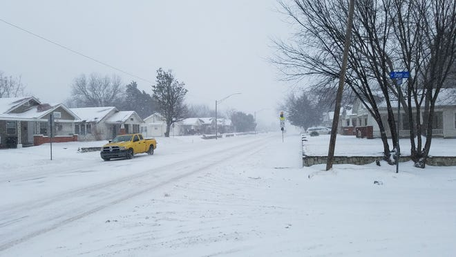 Traffic on Kickapoo was slow Sunday afternoon, as snow packed the roads and temperatures hovered in the single digits.