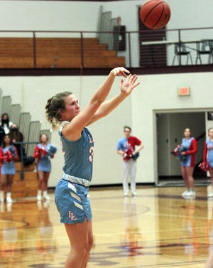 Madison Keil connects for a 3-pointer during the first quarter of Saturday night's regional finals.