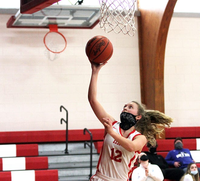 Colon's Brenna Fisher heads in for a layup against Burr Oak on Saturday.