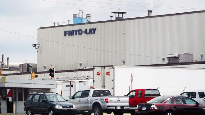 Two men on Friday dropped a lawsuit they were pursuing alleging a racist environment exists at the Frito-Lay Inc plant at 4236 S.W. Kirklawn, shown here. A third plaintiff continues to pursue the case.