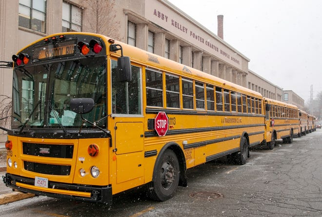 School buses arrive to pick up students at the Abby Kelley Foster Charter Public School in January.