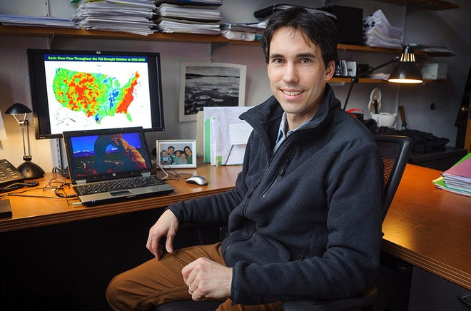 Clark Prof. Christopher Williams in his office.