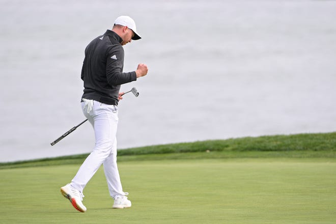 Daniel Berger reacts after an eagle putt on the 18th green during Sunday's final round of the Pebble Beach Pro-Am.