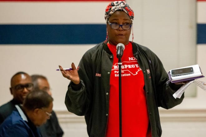 Carrol Olinger, grandparent of a student at T.C. Berrien speaks at a parents meeting for Cumberland County Schools on Nov. 19, 2019. The Fayetteville, N.C., school was closed and its student body was located to Spring Lake, N.C., which is 10 north, after mold and air-quality issues were discovered. Cumberland County Schools students have been learning through virtual instruction only since March of 2020 because of the COVID-19 pandemic.