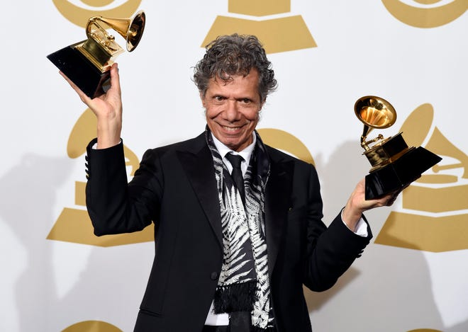 """Chick Corea poses in the press room with the awards for best improvised jazz solo for """"Fingerprints"""" and best jazz instrumental album for """"Trilogy"""" at the 57th annual Grammy Awards on Feb. 8, 2015, in Los Angeles. Corea, a towering jazz pianist with a staggering 23 Grammy awards who pushed the boundaries of the genre and worked alongside Miles Davis and Herbie Hancock, has died. He was 79. Corea died Feb. 9, of a rare form of cancer, his team posted on his web site. His death was confirmed by Corea's web and marketing manager, Dan Muse. [AP/Invision File Photo by Chris Pizzello]"""
