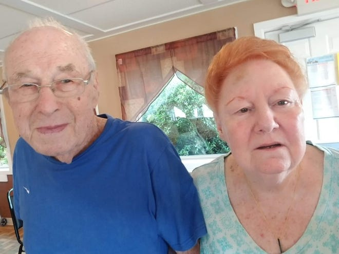 Robert Vielhauer is shown with his longtime companion Mabel Lewis, who died in a fire Monday morning.