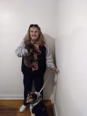 Kathy Reinhardt, pictured here with two of her pets, lost her home and two other pets in a fire. Reinhardt is a part-time instructor at Pueblo Community College.