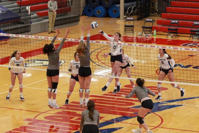 Payton Stack of the CSU Pueblo volleyball team blasts a shot at the net against Adams State University.