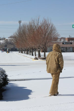 A Puebloan walks past The Pueblo Chieftain building on Monday. According to the National Weather Service of Pueblo, 3.7 inches of snow accumulated across the Steel City over the weekend.