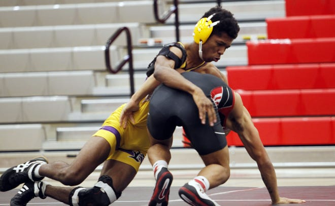 Reynoldsburg's Michael Dawkins (top) finished the regular season 16-1 overall and 4-0 in OCC-Buckeye matches.The senior 132-pounder will compete Feb. 27 in a Division I sectional at Upper Arlington.