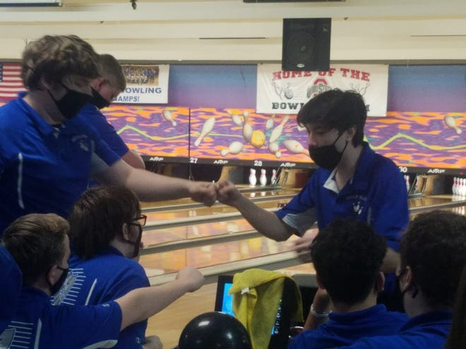 Ready's Philip Ryan (right) fist bumps Luke Jahn during the Division II district tournament Feb. 15 at HP Lanes. Jahn rolled a 604 to finish fourth and advance to state Feb. 27 at Wayne Webb's Columbus Bowl.