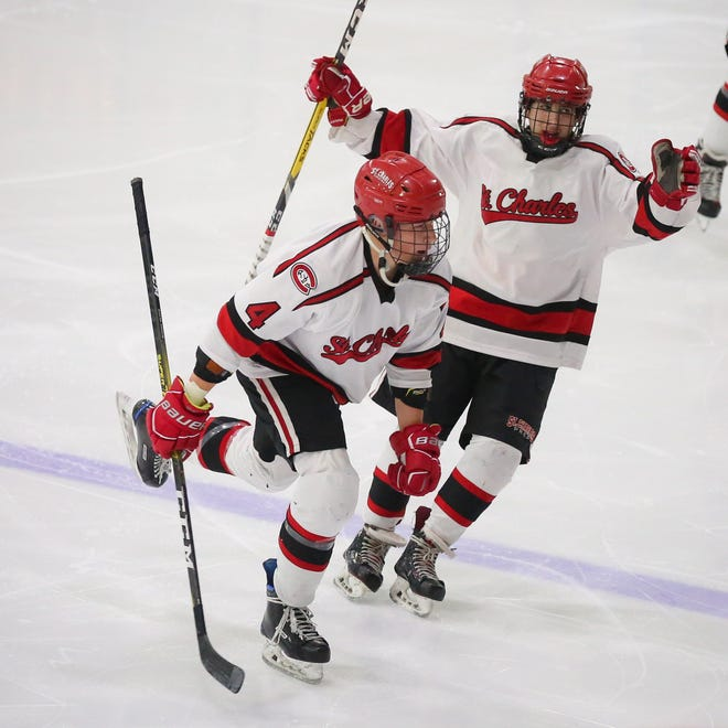 St. Charles' Erich Schoettmer (4) celebrates with teammate Dominick Evangelisti after a goal during the Blue Jackets Cup championship game Feb. 14 at OhioHealth Ice Haus. Schoettmer is one of several key defensemen who have stymied opposing offenses this season.