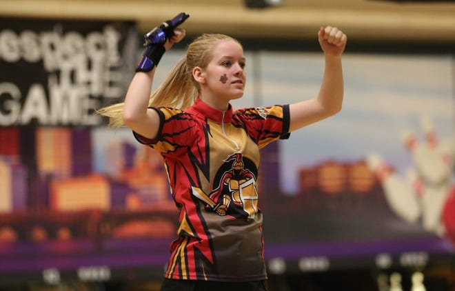 Worthington Christian's Lilly Marsh celebrates a strike during last season's Division II state tournament. In the district tournament Feb. 15 at HP Lanes, Marsh helped the Warriors earn another state berth.