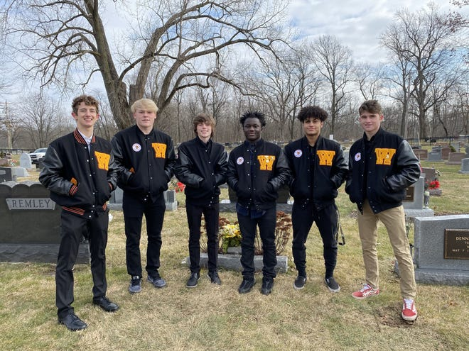 (From left) Westerville North wrestlers Jake Gooding, Brennan Albertini, Evan Butcher, Sylvester Bockarie, Nico Candido and Nate Morse were pallbearers in January for Gahanna resident Mary Ann Altizer. The Warriors program has become a go-to source for helping members of the community, according to coach David Grant.