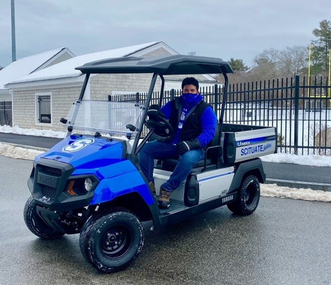 Scituate High School Athletic Director Peter Umbrianna is excited about his department's new golf medical/utility cart funded by SHORE.