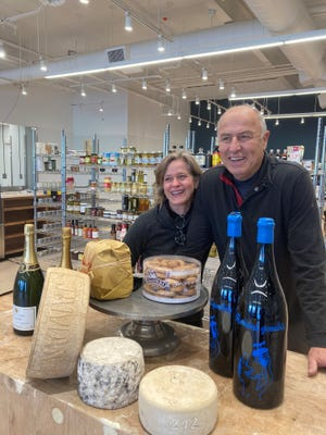 Valerie and Ihsan Gurdal, owners of Formaggio Kitchen, pictured inside their new space at 360 Huron Ave. The couple took over the former location of Fresh Pond Market, moving from Formaggio Kitchen's original site just blocks away at 244 Huron Ave.